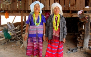 Pim's (another student at Jen's House) grandmother and her friend. They wear traditional Karen clothing and beads. The beads are worn because they are beautiful.  This picture was taken at Ni ki's brother's house during the string tying ceremony, which occurs every year.
