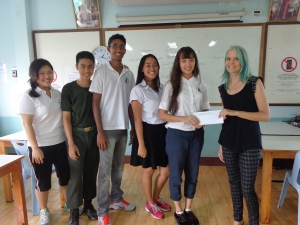 Pooh, Krit, Dong Eun, Emily, and Narissa, present Ingi with the funds they raised for the our post-secondary students.